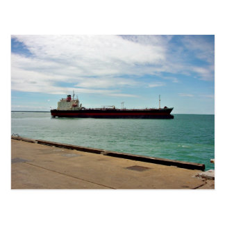 Freighter ship sailing on sea post card