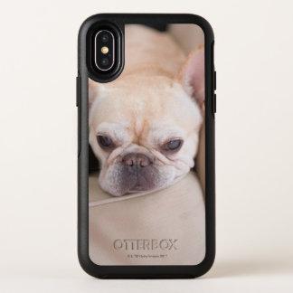 French bulldog resting on sofa OtterBox symmetry iPhone x case