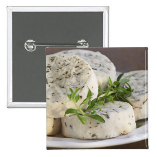 French goat cheese - chevre - with herbs on a button