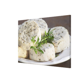 French goat cheese - chevre - with herbs on a canvas print