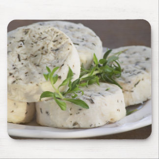 French goat cheese - chevre - with herbs on a mouse pad
