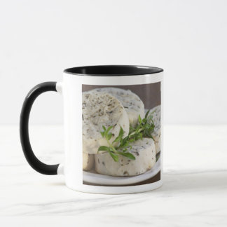 French goat cheese - chevre - with herbs on a mug