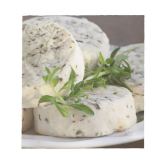 French goat cheese - chevre - with herbs on a notepad