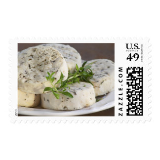French goat cheese - chevre - with herbs on a postage