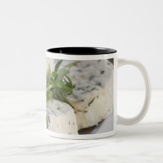 French goat cheese - chevre - with herbs on a Two-Tone coffee mug