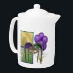 "French Quarter Teapot<br><div class=""desc"">Reminiscent of scenes from the French Quarter in New Orleans, here is a medium white Porcelain teapot with an image, on both sides, of purple balloons, a gold star balloon weight, green and gold squares, a gorgeous green and purple sequin mask, and a silhouettes of female dancer. See matching candy...</div>"