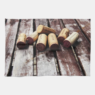 french wine bottle corks on rustic wooden texture kitchen towels