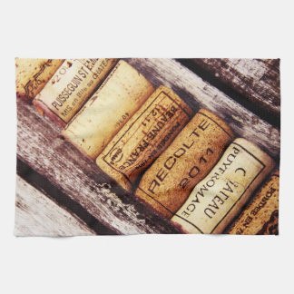 french wine bottle corks on rustic wooden texture towels