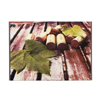 french wine corks on rustic wood background covers for iPad mini