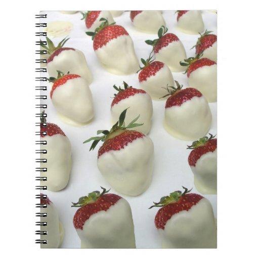 Fresas sumergidas en el chocolate blanco note book