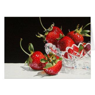 Fresas y tarjeta de felicitación cristalina