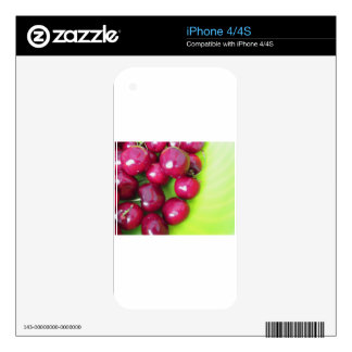 Fresh cherries on green background decal for the iPhone 4