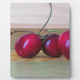 Fresh cherries on the table plaque