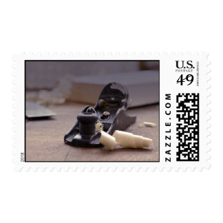 Fresh curly wood shavings on table postage stamp