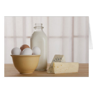 Fresh eggs cheese and milk on counter card