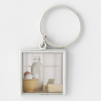 Fresh eggs cheese and milk on counter keychain