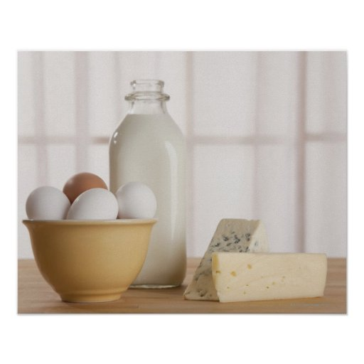 Fresh eggs cheese and milk on counter poster