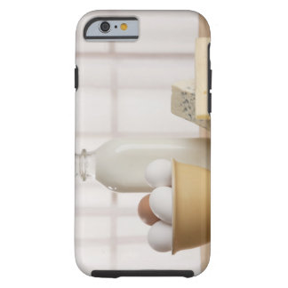 Fresh eggs cheese and milk on counter tough iPhone 6 case