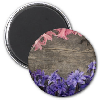 fresh flowers on the old wooden background 2 inch round magnet