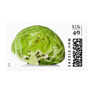 Fresh iceberg lettuce cut in half, on white postage