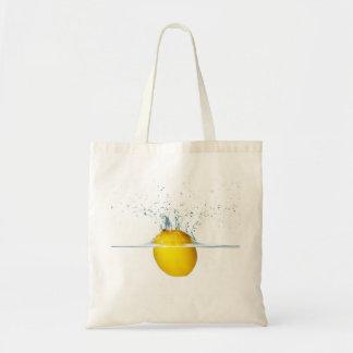 Fresh Lemon Falling Into Water Tote Bag