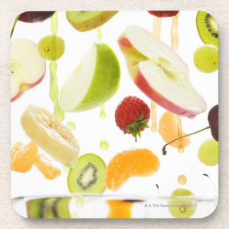 Fresh mixed fruit with apple & orange juice drink coaster