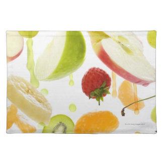 Fresh mixed fruit with apple & orange juice placemat
