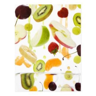 Fresh mixed fruit with apple & orange juice postcard