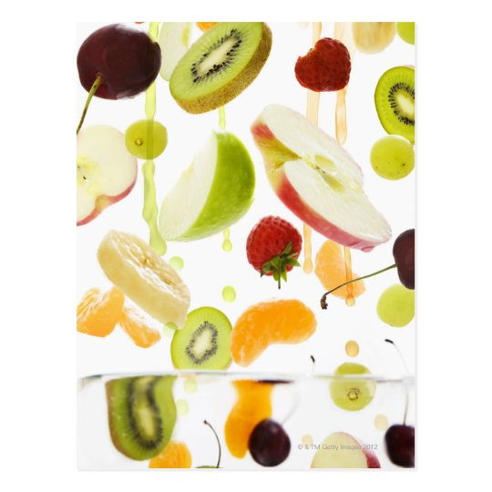 Fresh mixed fruit with apple & orange juice postcard