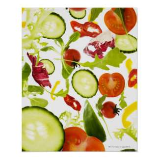 Fresh mixed salad vegetables falling to camera poster