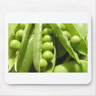Fresh open green pea pods in sunlight mouse pad