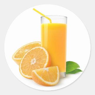 Fresh orange juice in a glass classic round sticker