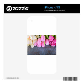 Fresh pink tulips on gray stone background decal for the iPhone 4