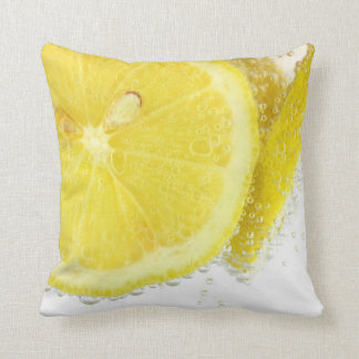 Fresh real lemons in water close up throw pillow