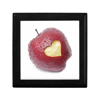 Fresh red apple with a heart shaped symbol gift box