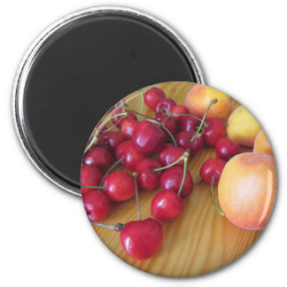 Fresh summer fruits on light wooden table magnet