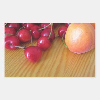 Fresh summer fruits on light wooden table rectangular sticker