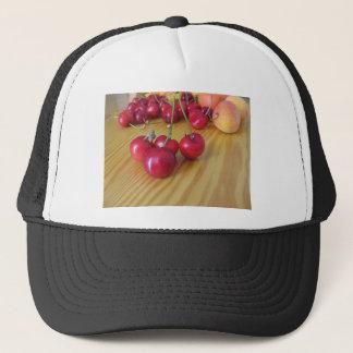 Fresh summer fruits on light wooden table trucker hat