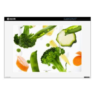 Fresh vegetables with water falling into a bowl decals for laptops
