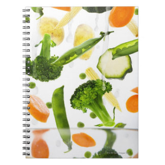 Fresh vegetables with water falling into a bowl notebook