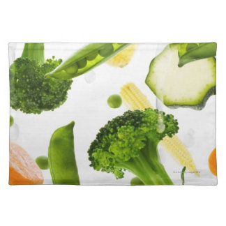 Fresh vegetables with water falling into a bowl placemat