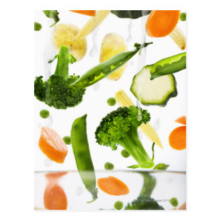 Fresh vegetables with water falling into a bowl postcard