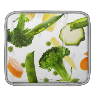 Fresh vegetables with water falling into a bowl sleeve for iPads