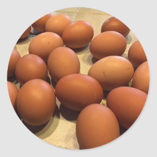 Freshly gathered brown eggs classic round sticker
