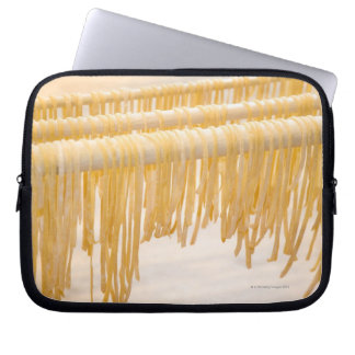 Freshly made pasta drying on a wooden rack laptop computer sleeve