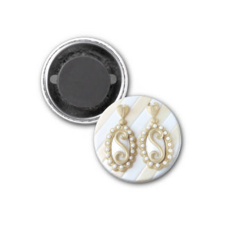 fridge magnet featuring glamorous earrings.