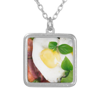 Fried eggs and bacon with herbs and lettuce silver plated necklace