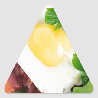 Fried eggs and bacon with herbs and lettuce triangle sticker