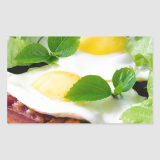 Fried eggs with herbs, lettuce and  bacon rectangular sticker