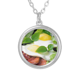 Fried eggs with herbs, lettuce and  bacon silver plated necklace